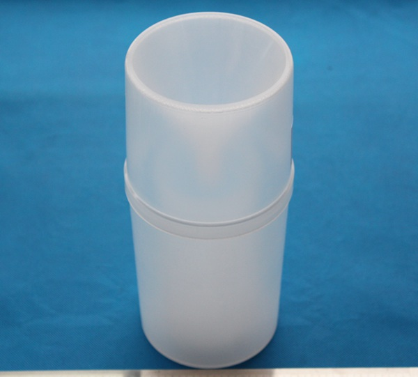 Plastic rain gauge with measuring cylinder